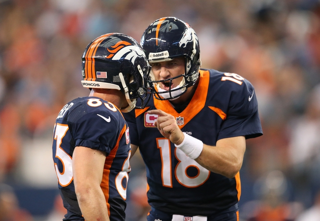 Oct 6, 2013; Arlington, TX, USA; Denver Broncos quarterback Peyton Manning (18) talks with receiver Wes Welker (83) in the third quarter against the Dallas Cowboys at AT&T Stadium. Mandatory Credit: Matthew Emmons-USA TODAY Sports