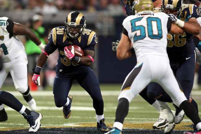 Oct 6, 2013; St. Louis, MO, USA; Jacksonville Jaguars running back Jordan Todman (30) carries the ball during the second half against the Jacksonville Jaguars at The Edward Jones Dome. Mandatory Credit: Scott Kane-USA TODAY Sports