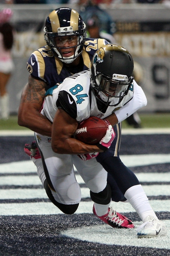 Oct 6, 2013; St. Louis, MO, USA; Jacksonville Jaguars wide receiver Cecil Shorts (84) scores a touchdown during the fourth quarter while under pressure from St. Louis Rams cornerback Trumaine Johnson (22) at The Edward Jones Dome. Mandatory Credit: Scott Kane-USA TODAY Sports