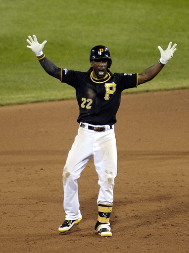 Oct 6, 2013; Pittsburgh, PA, USA; Pittsburgh Pirates center fielder Andrew McCutchen (22) reacts after hitting a double against the St. Louis Cardinals in game three of the National League divisional series playoff baseball game at PNC Park. Mandatory Credit: H.Darr Beiser-USA TODAY Sports