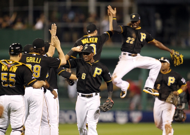 Oct 6, 2013; Pittsburgh, PA, USA; Pittsburgh Pirates players including Starling Marte (6) , Russell Martin (55) , Jason Grilli (39) , Marlon Byrd (2) and Andrew McCutchen (22) celebrate after game three of the National League divisional series playoff baseball game against the St. Louis Cardinals at PNC Park. Mandatory Credit: Charles LeClaire-USA TODAY Sports