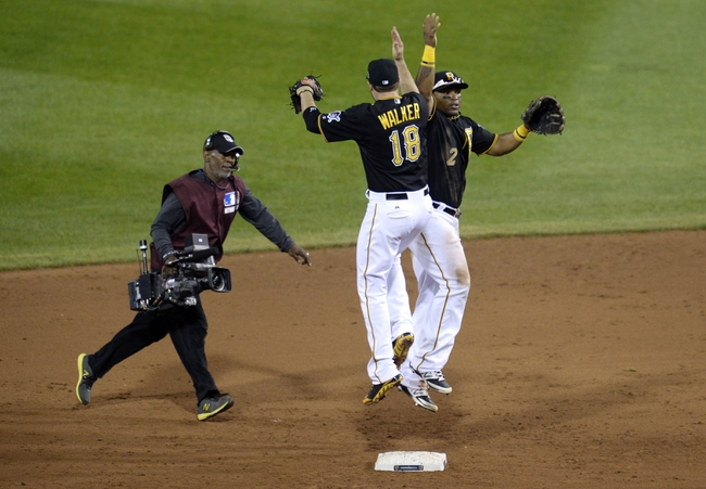 Oct 6, 2013; Pittsburgh, PA, USA; Pittsburgh Pirates players Neil Walker (18) and Marlon Byrd (2) celebrate after game three of the National League divisional series playoff baseball game against the St. Louis Cardinals at PNC Park. Mandatory Credit: H.Darr Beiser-USA TODAY Sports