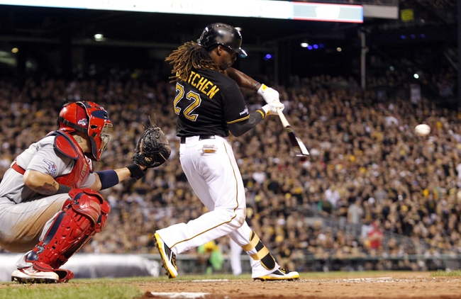 Oct 6, 2013; Pittsburgh, PA, USA; Pittsburgh Pirates center fielder Andrew McCutchen (22) hits a double against the St. Louis Cardinals in the 8th inning in game three of the National League divisional series playoff baseball game at PNC Park. Mandatory Credit: Charles LeClaire-USA TODAY Sports