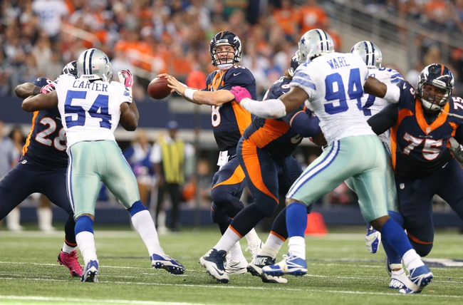 Oct 6, 2013; Arlington, TX, USA; Denver Broncos quarterback Peyton Manning (18) throws in the pocket against the Dallas Cowboys at AT&T Stadium.  The Denver Broncos beat the Dallas Cowboys 51-48. Mandatory Credit: Matthew Emmons-USA TODAY Sports