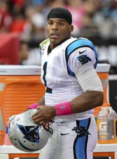 Oct 6, 2013; Phoenix, AZ, USA; Carolina Panthers quarterback Cam Newton (1) looks on during the second half against the Arizona Cardinals at University of Phoenix Stadium. Mandatory Credit: Matt Kartozian-USA TODAY Sports