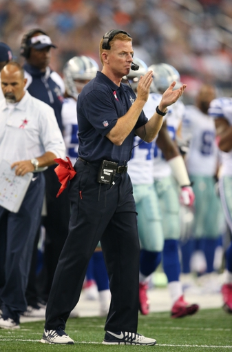 Oct 6, 2013; Arlington, TX, USA; Dallas Cowboys head coach Jason Garrett claps on the sidelines against the Denver Broncos at AT&T Stadium.  The Denver Broncos beat the Dallas Cowboys 51-48. Mandatory Credit: Matthew Emmons-USA TODAY Sports