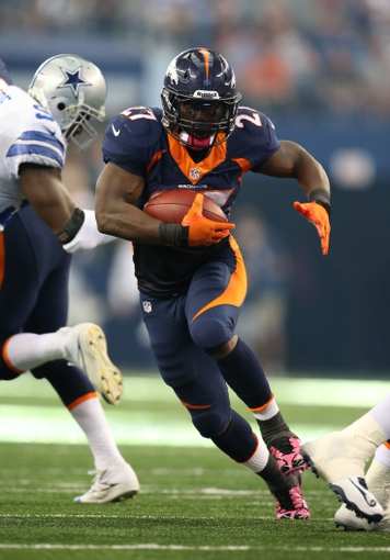 Oct 6, 2013; Arlington, TX, USA; Denver Broncos running back Knowshon Moreno (27) runs with the ball against the Dallas Cowboys at AT&T Stadium.  The Denver Broncos beat the Dallas Cowboys 51-48. Mandatory Credit: Matthew Emmons-USA TODAY Sports