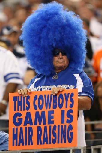 Oct 6, 2013; Arlington, TX, USA; Dallas Cowboys fan holds a sign during the game against the Denver Broncos at AT&T Stadium.  The Denver Broncos beat the Dallas Cowboys 51-48. Mandatory Credit: Matthew Emmons-USA TODAY Sports