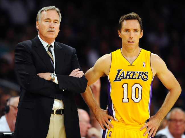 Oct 6, 2013; Los Angeles, CA, USA; Los Angeles Lakers head coach Mike D'Antoni (left) stands with guard Steve Nash (10) during the first half against the Denver Nuggets at Staples Center. Mandatory Credit: Christopher Hanewinckel-USA TODAY Sports