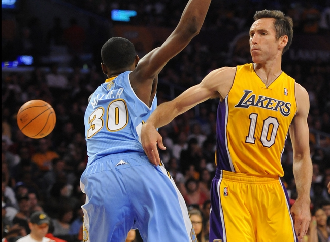 Oct 6, 2013; Los Angeles, CA, USA; Los Angeles Lakers guard Steve Nash (10) passes the ball away from Denver Nuggets forward Quincy Miller (30) during the first half at Staples Center. Mandatory Credit: Christopher Hanewinckel-USA TODAY Sports