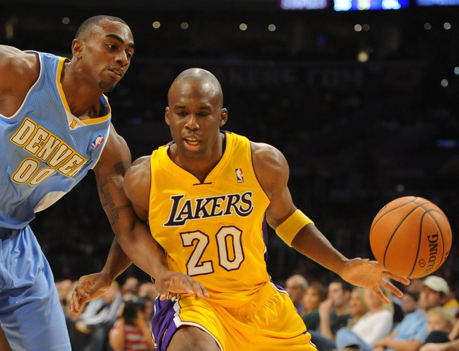 Oct 6, 2013; Los Angeles, CA, USA; Los Angeles Lakers guard Jodie Meeks (20) works against Denver Nuggets forward Darrell Arthur (00) during the first half at Staples Center. Mandatory Credit: Christopher Hanewinckel-USA TODAY Sports