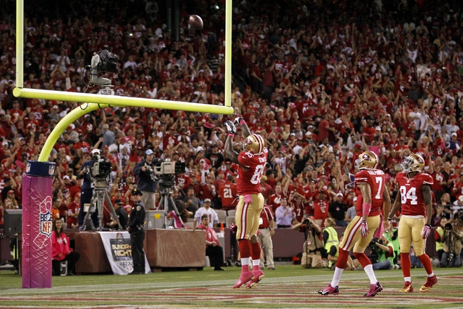 Oct 6, 2013; San Francisco, CA, USA; San Francisco 49ers tight end Vernon Davis (85) shoots the ball through the field goal post after scoring a touchdown against the Houston Texans in the fourth quarter at Candlestick Park. The 49ers defeated the Texans 34-3. Mandatory Credit: Cary Edmondson-USA TODAY Sports