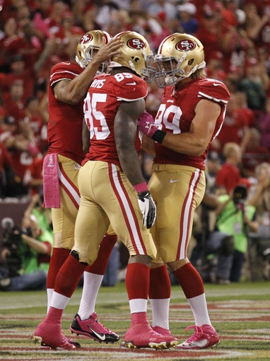 Oct 6, 2013; San Francisco, CA, USA; San Francisco 49ers tight end Vernon Davis (85) is congratulated by quarterback Colin Kaepernick (7) and tight end Vance McDonald (89) after scoring a touchdown against the Houston Texans in the fourth quarter at Candlestick Park. The 49ers defeated the Texans 34-3. Mandatory Credit: Cary Edmondson-USA TODAY Sports