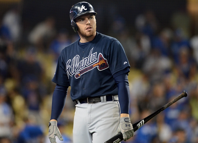 October 6, 2013; Los Angeles, CA, USA; Atlanta Braves first baseman Freddie Freeman (5) reacts after striking out in the ninth inning against the Los Angeles Dodgers in game three of the National League divisional series playoff baseball game at Dodger Stadium. Mandatory Credit: Jayne Kamin-Oncea-USA TODAY Sports