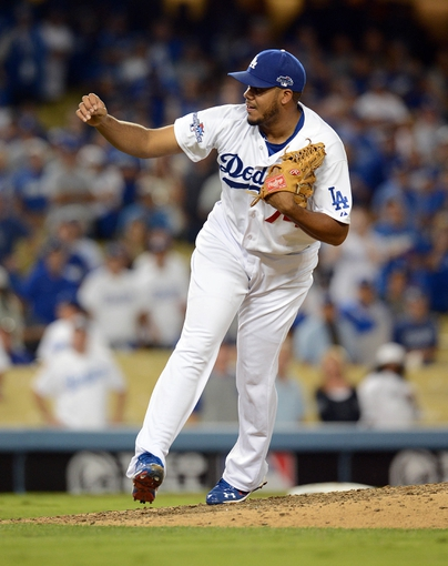 October 6, 2013; Los Angeles, CA, USA; Los Angeles Dodgers relief pitcher Kenley Jansen (74) pitches the ninth inning against the Atlanta Braves in game three of the National League divisional series playoff baseball game at Dodger Stadium. Mandatory Credit: Jayne Kamin-Oncea-USA TODAY Sports