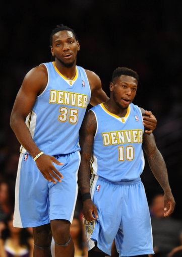 Oct 6, 2013; Los Angeles, CA, USA; Denver Nuggets forward Kenneth Faried (35) and guard Nate Robinson (10) after Robinson was called for a technical foul during the second half against the Los Angeles Lakers at Staples Center. The Nuggets won 97-88. Mandatory Credit: Christopher Hanewinckel-USA TODAY Sports