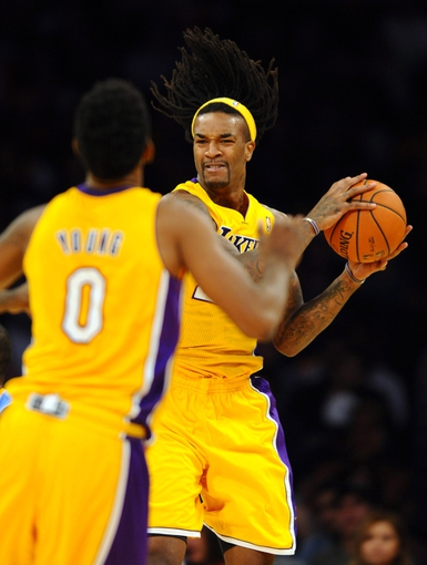Oct 6, 2013; Los Angeles, CA, USA; Los Angeles Lakers center Jordan Hill (27) grabs a rebound and looks to pass the ball to guard Nick Young (0) during the second half against the Denver Nuggets at Staples Center. The Nuggets won 97-88. Mandatory Credit: Christopher Hanewinckel-USA TODAY Sports