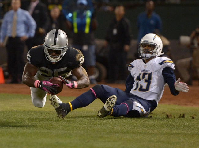 Oct 6, 2013; Oakland, CA, USA; Oakland Raiders cornerback D.J. Hayden (25) intercepts a pass in the end zone intended for San Diego Chargers receiver Keenan Allen (13) with 1:48 to play at O.co Coliseum. The Raiders defeated the Chargers 27-17. Mandatory Credit: Kirby Lee-USA TODAY Sports
