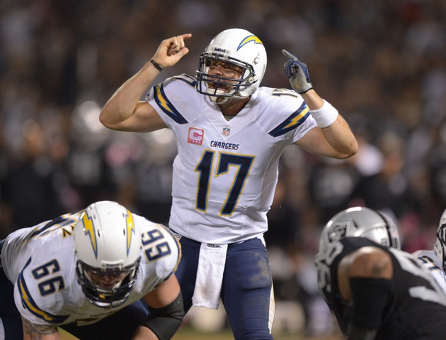 Oct 6, 2013; Oakland, CA, USA; San Diego Chargers quarterback Philip Rivers (17) reacts during the game against the Oakland Raiders at O.co Coliseum. The Raiders defeated the Chargers 27-17. Mandatory Credit: Kirby Lee-USA TODAY Sports