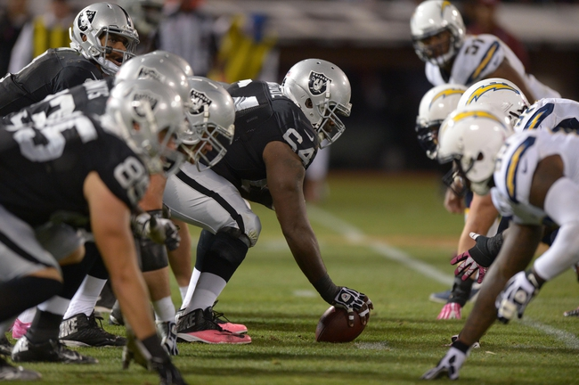 Oct 6, 2013; Oakland, CA, USA; General view of the line of scrimmage as Oakland Raiders center Andre Gurode (64) snaps the ball to quarterback Terrelle Pryor (2) during the game against the San Diego Chargers at O.co Coliseum. The Raiders defeated the Chargers 27-17. Mandatory Credit: Kirby Lee-USA TODAY Sports