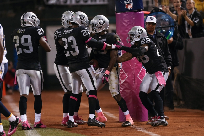 Oct 6, 2013; Oakland, CA, USA; Oakland Raiders cornerback DJ Hayden (25) celebrates with teammates after intercepting a pass in the end zone during the fourth quarter at O.co Coliseum. The Oakland Raiders defeated the San Diego Chargers 27-17. Mandatory Credit: Kelley L Cox-USA TODAY Sports