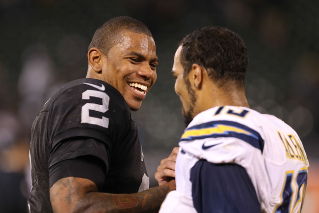 Oct 6, 2013; Oakland, CA, USA; Oakland Raiders quarterback Terrelle Pryor (2) shakes hands with San Diego Chargers wide receiver Keenan Allen (13) after the game at O.co Coliseum. The Oakland Raiders defeated the San Diego Chargers 27-17. Mandatory Credit: Kelley L Cox-USA TODAY Sports