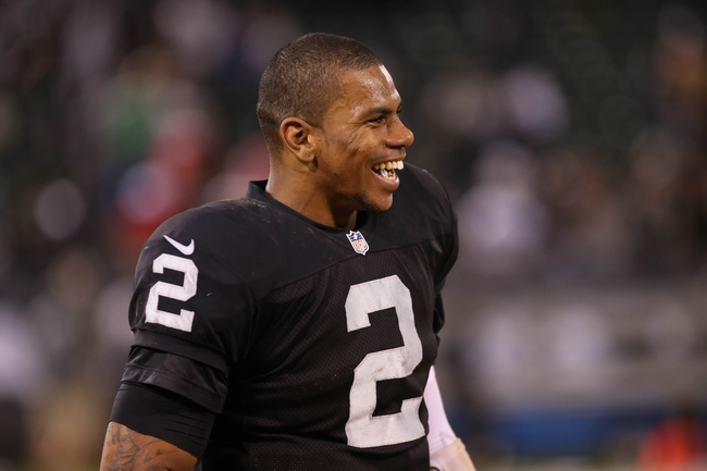 Oct 6, 2013; Oakland, CA, USA; Oakland Raiders quarterback Terrelle Pryor (2) smiles after the game against the San Diego Chargers at O.co Coliseum. The Oakland Raiders defeated the San Diego Chargers 27-17. Mandatory Credit: Kelley L Cox-USA TODAY Sports