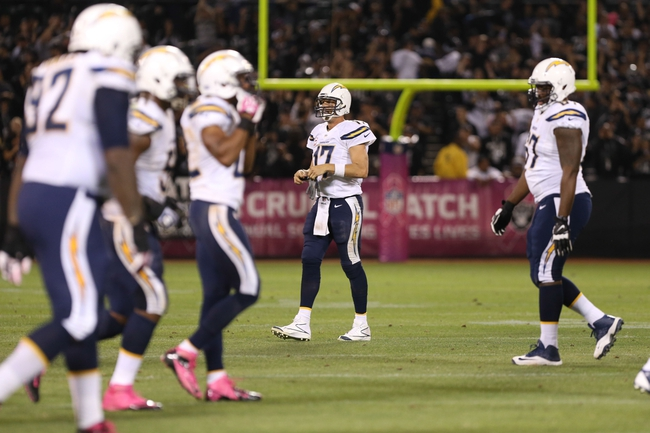 Oct 6, 2013; Oakland, CA, USA; San Diego Chargers quarterback Philip Rivers (17) removes his gloves after an Oakland Raiders interception during the fourth quarter at O.co Coliseum. The Oakland Raiders defeated the San Diego Chargers 27-17. Mandatory Credit: Kelley L Cox-USA TODAY Sports