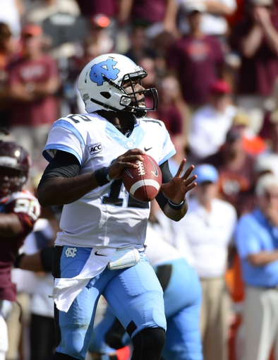 Oct 5, 2013; Blacksburg, VA, USA; North Carolina Tar Heels quarterback Marquise Williams (12) looks to pass in the third quarter. The Hokies defeated the Tar Heels 27-17 at Lane Stadium. Mandatory Credit: Bob Donnan-USA TODAY Sports