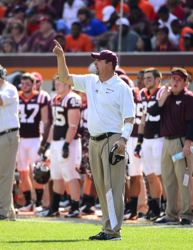 Oct 5, 2013; Blacksburg, VA, USA; Virginia Tech Hokies defensive coordinator Bud Foster reacts in the fourth quarter. The Hokies defeated the Tar Heels 27-17 at Lane Stadium. Mandatory Credit: Bob Donnan-USA TODAY Sports
