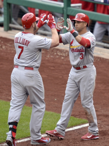 Oct 7, 2013; Pittsburgh, PA, USA; St. Louis Cardinals left fielder Matt Holliday (7) is congratulated by right fielder Carlos Beltran (3) after hitting a two-run home run against the Pittsburgh Pirates in the sixth inning in game four of the National League divisional series playoff baseball game at PNC Park. Mandatory Credit: H.Darr Beiser-USA TODAY Sports