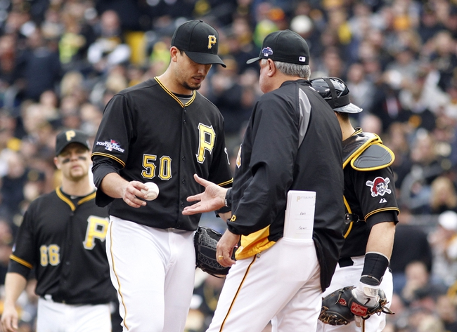 Oct 7, 2013; Pittsburgh, PA, USA; Pittsburgh Pirates starting pitcher Charlie Morton (50) is relieved by manager Clint Hurdle (right) during the sixth inning against the St. Louis Cardinals in game four of the National League divisional series playoff baseball game at PNC Park. Mandatory Credit: Charles LeClaire-USA TODAY Sports