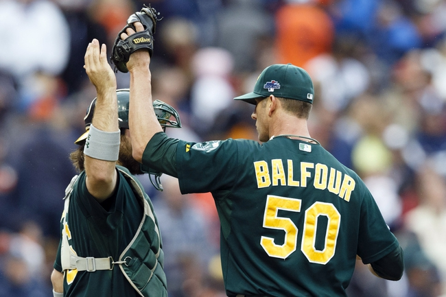 Oct 7, 2013; Detroit, MI, USA; Oakland Athletics relief pitcher Grant Balfour (50) and catcher Derek Norris (36) celebrate after game three of the American League divisional series playoff baseball game against the Detroit Tigers at Comerica Park. Oakland won 6-3. Mandatory Credit: Rick Osentoski-USA TODAY Sports