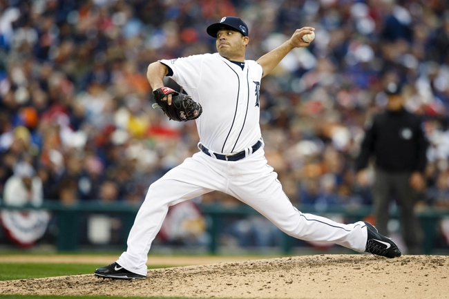 Oct 7, 2013; Detroit, MI, USA; Detroit Tigers pitcher Jose Alvarez (52) pitches in the seventh inning against the Oakland Athletics in game three of the American League divisional series playoff baseball game at Comerica Park. Mandatory Credit: Rick Osentoski-USA TODAY Sports
