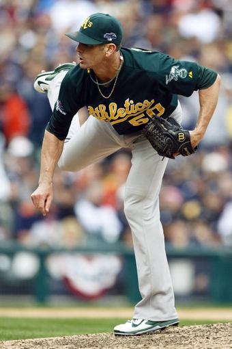 Oct 7, 2013; Detroit, MI, USA; Oakland Athletics relief pitcher Grant Balfour (50) pitches in the ninth inning against the Detroit Tigers in game three of the American League divisional series playoff baseball game at Comerica Park. Oakland won 6-3. Mandatory Credit: Rick Osentoski-USA TODAY Sports