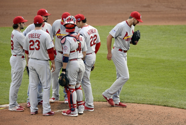 Oct 7, 2013; Pittsburgh, PA, USA; St. Louis Cardinals starting pitcher Michael Wacha (right) heads back to the dugout after being relieved in the 8th inning in game four of the National League divisional series playoff baseball game against the Pittsburgh Pirates at PNC Park. Mandatory Credit: H.Darr Beiser-USA TODAY Sports