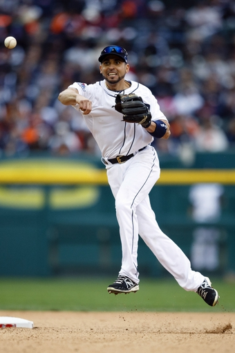 Oct 7, 2013; Detroit, MI, USA; Detroit Tigers second baseman Omar Infante (4) makes a throw to first for an out in game three of the American League divisional series playoff baseball game against the Oakland Athletics at Comerica Park. Mandatory Credit: Rick Osentoski-USA TODAY Sports