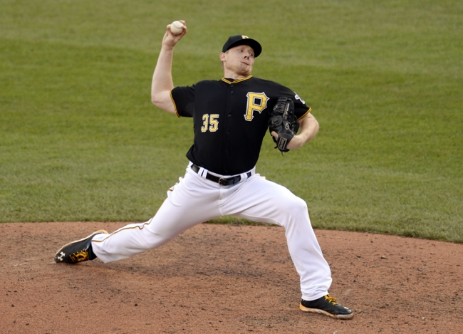 Oct 7, 2013; Pittsburgh, PA, USA; Pittsburgh Pirates relief pitcher Mark Melancon throws a pitch against the St. Louis Cardinals in game four of the National League divisional series playoff baseball game at PNC Park. Mandatory Credit: H.Darr Beiser-USA TODAY Sports