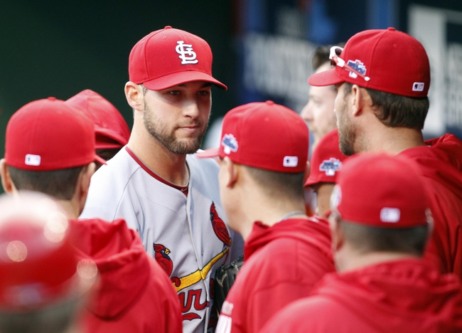 Oct 7, 2013; Pittsburgh, PA, USA; St. Louis Cardinals starting pitcher Michael Wacha (facing forward) in the dugout after being relieved in the 8th inning in game four of the National League divisional series playoff baseball game against the Pittsburgh Pirates at PNC Park. Mandatory Credit: Charles LeClaire-USA TODAY Sports