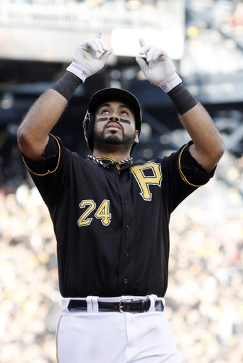 Oct 7, 2013; Pittsburgh, PA, USA; Pittsburgh Pirates third baseman Pedro Alvarez (24) points skyward after hitting a solo home run against the St. Louis Cardinals in the 8th inning in game four of the National League divisional series playoff baseball game at PNC Park. Mandatory Credit: Charles LeClaire-USA TODAY Sports