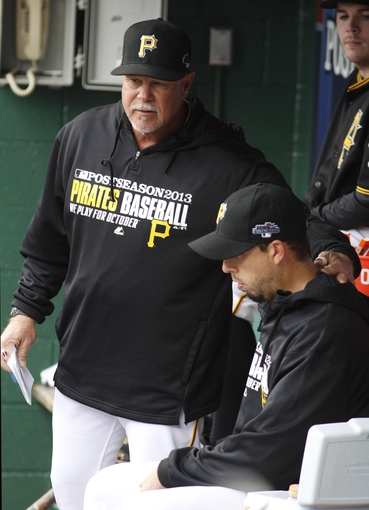 Oct 7, 2013; Pittsburgh, PA, USA; Pittsburgh Pirates pitching coach Ray Searage (left) pats starting pitcher Charlie Morton (right) on the back after Morton was removed from the game against the St. Louis Cardinals during the sixth inning in game four of the National League divisional series at PNC Park. The St. Louis Cardinals won 2-1. Mandatory Credit: Charles LeClaire-USA TODAY Sports