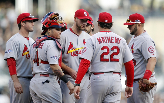 Oct 7, 2013; Pittsburgh, PA, USA; St. Louis Cardinals manager Mike Matheny (22) comes out to relieve starting pitcher Michael Wacha (middle) in the 8th inning in game four of the National League divisional series playoff baseball game against the Pittsburgh Pirates at PNC Park. Mandatory Credit: Charles LeClaire-USA TODAY Sports