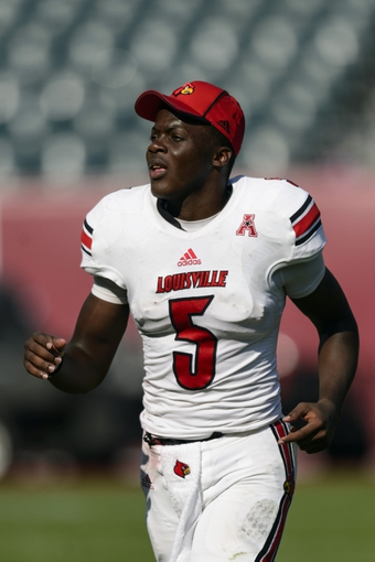 Oct 5, 2013; Philadelphia, PA, USA; Louisville Cardinals quarterback Teddy Bridgewater (5) after the game against the Temple Owls at Lincoln Financial Field. Louisville defeated Temple 30-7. Mandatory Credit: Howard Smith-USA TODAY Sports