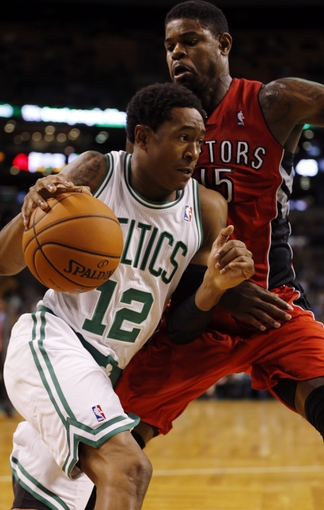 Oct 7, 2013; Boston, MA, USA; Boston Celtics forward/guard MarShon Brooks (12) drives the ball against Toronto Raptors power forward Amir Johnson (15) in the first half at TD Garden. Mandatory Credit: David Butler II-USA TODAY Sports