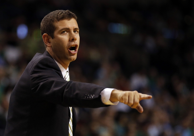 Oct 7, 2013; Boston, MA, USA; Boston Celtics head coach Brad Stevens reacts from the sideline as they take on the Toronto Raptors in the first half at TD Garden. Mandatory Credit: David Butler II-USA TODAY Sports