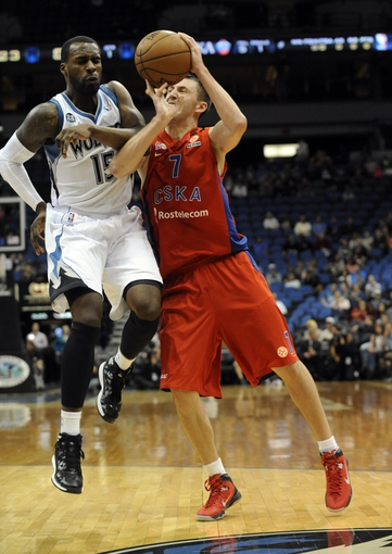 Oct 7, 2013; Minneapolis, MN, USA;  CSKA Moscow guard Vitaly Fridzon (7) colides with Minnesota Timberwolves forward Shabazz Muhammad (15) on a shot attempt in the second quarter at Target Center. Mandatory Credit: Marilyn Indahl-USA TODAY Sports