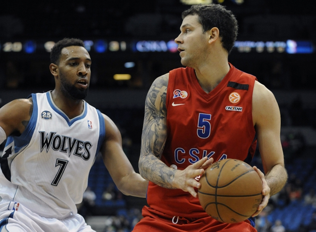 Oct 7, 2013; Minneapolis, MN, USA;  CSKA Moscow forward Vladimir Micov (5) looks to pass against Minnesota Timberwolves forward Derrick Williams (7) in the first quarter at Target Center. Mandatory Credit: Marilyn Indahl-USA TODAY Sports