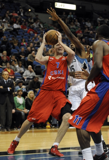 Oct 7, 2013; Minneapolis, MN, USA;  CSKA Moscow guard Vitaly Fridzon (7) looks to shoot against Minnesota Timberwolves forward Shabazz Muhammad (15) in the first quarter at Target Center. Mandatory Credit: Marilyn Indahl-USA TODAY Sports