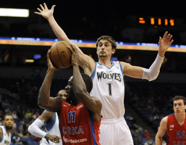 Oct 7, 2013; Minneapolis, MN, USA;  CSKA Moscow guard Jeremy Pargo (11) drives to the basket against Minnesota Timberwolves guard Alexey Shved (1) in the second quarter at Target Center. Mandatory Credit: Marilyn Indahl-USA TODAY Sports