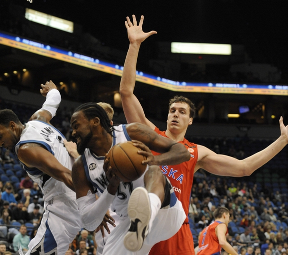 Oct 7, 2013; Minneapolis, MN, USA;  Minnesota Timberwolves center Ronny Turiaf (32) grabs a rebound in the second quarter against the CSKA Moscow at Target Center. Mandatory Credit: Marilyn Indahl-USA TODAY Sports